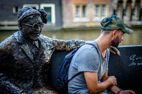 Streets of Amsterdam. Boy and bronze old man.
